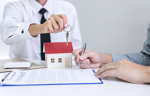 Offer Accepted - realestae person handing keys to client